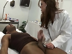 sexy brunette doctor sucks black cock on examination bed