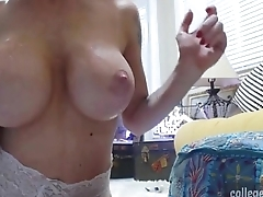 cam whore with heavy natural tits trains her throat live on collegecamz.com