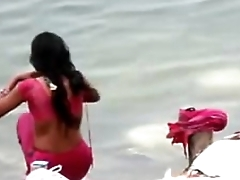 Indian dame wash up in ganges river backless open